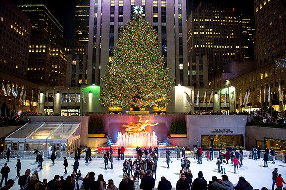 NEW YORK CITY, USA - DECEMBER 10, 2015: Ice skaters fill the skating rink under the Rockefeller Center Christmas tree.
