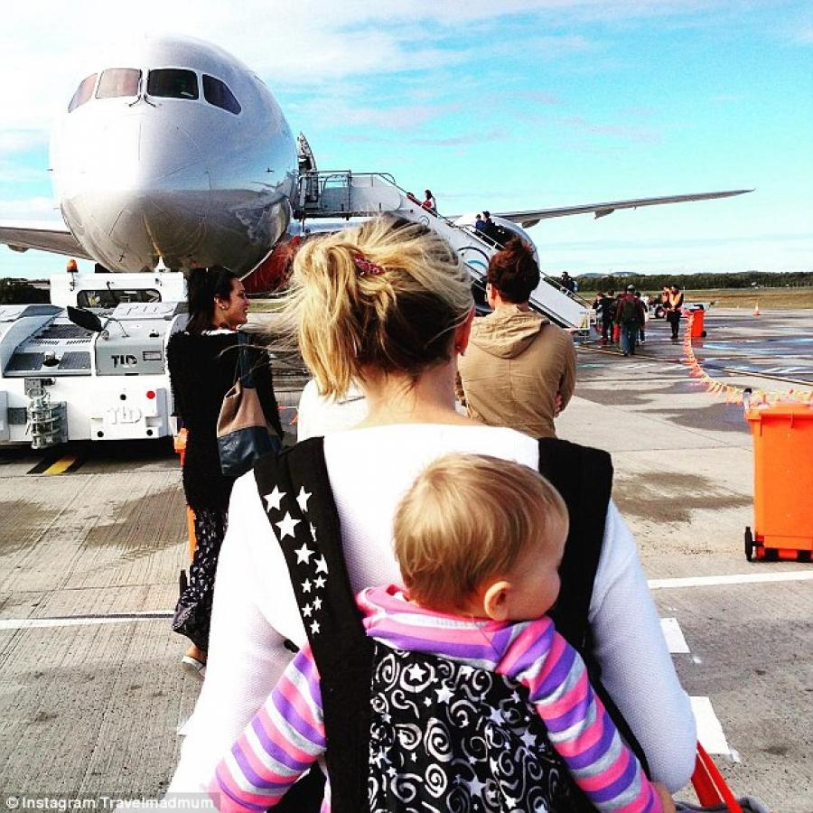 Pictured_boarding_a_plane_at_Brisbane_Airport__Karen_said_she_has_no_regrets_taking_her_daughter_travelling_764892913